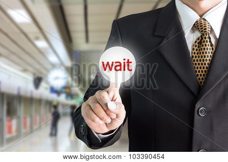 Businessman hand pointing on the screen press the button wait - can be used for editing text or imag