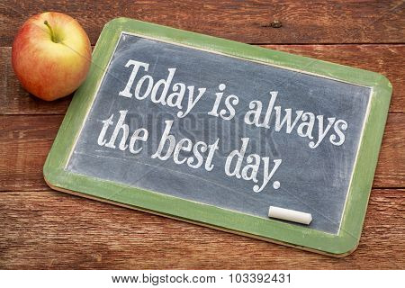 Today is always the best day - positive words on a slate blackboard against red barn wood