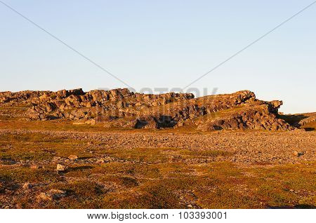 Summer Landscape Of Rocky Tundra At Sunset