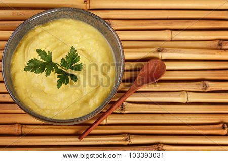 Vegetable Cream Soup With Parsley On Bamboo