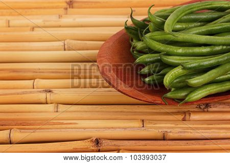 Fresh Green Beans On Bamboo Table