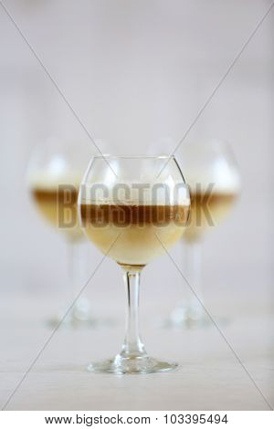 Wine glass with jelly on light background