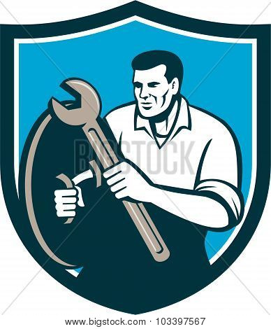 Mechanic Brandishing Spanner Wrench Shield Retro