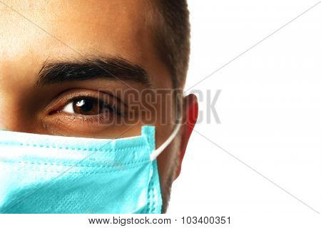 Young male doctor on white background