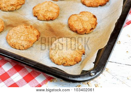 Homemade cookies on baking sheet close up