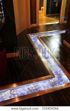 Glass floor in restaurant's vestibule