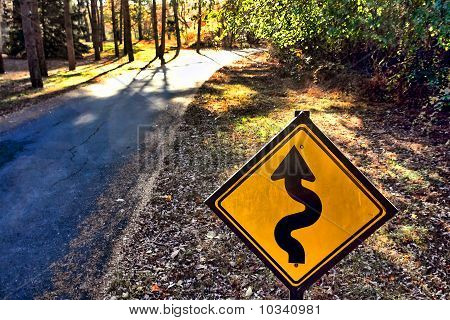 Winding Road Curves Ahead Traffic Warning Sign On Country Road