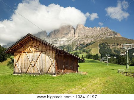 hut in alpine meadow
