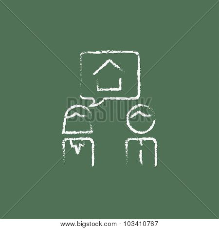 Couple dreaming about the house hand drawn in chalk on a blackboard vector white icon isolated on a green background.