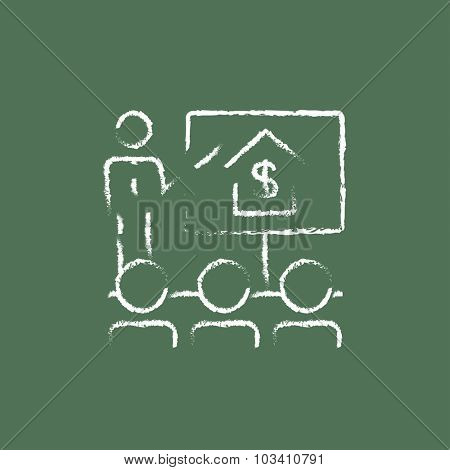 Real estate training hand drawn in chalk on a blackboard vector white icon isolated on a green background.