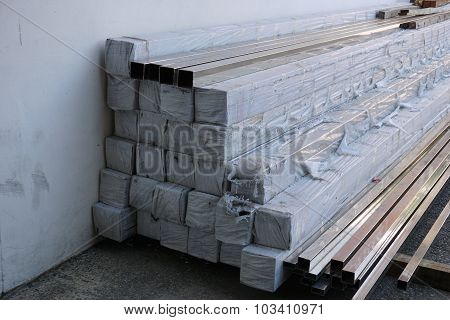 Stack Of Metal Tube In Warehouse