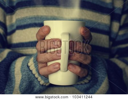 Warm Cup Of Hot Tea  Warming In The Hands