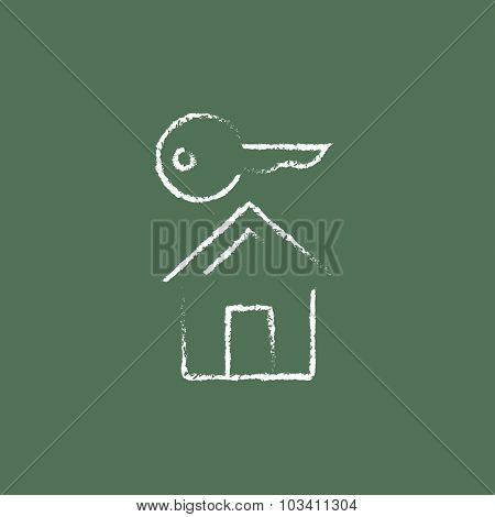 Key for house hand drawn in chalk on a blackboard vector white icon isolated on a green background.