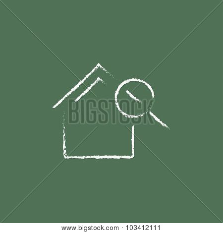House and magnifying glass hand drawn in chalk on a blackboard vector white icon isolated on a green background.