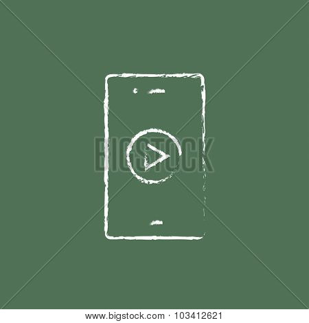 Smartphone hand drawn in chalk on a blackboard vector white icon isolated on a green background.