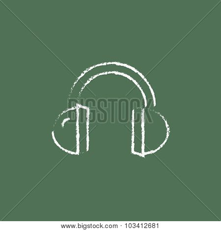 Headphone hand drawn in chalk on a blackboard vector white icon isolated on a green background.