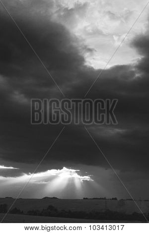 Colorful Dramatic Sky With Sunbeams And Heavy Clouds At Sunset