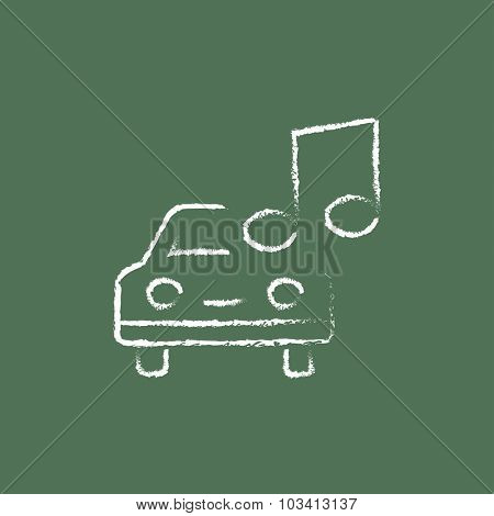 Car with music note hand drawn in chalk on a blackboard vector white icon isolated on a green background.