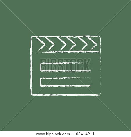 Clapboard hand drawn in chalk on a blackboard vector white icon isolated on a green background.