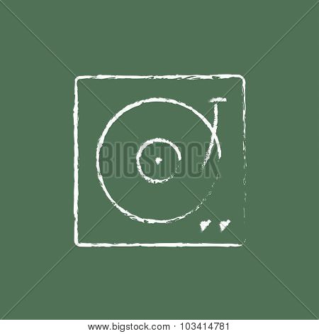 Turntable hand drawn in chalk on a blackboard vector white icon isolated on a green background.