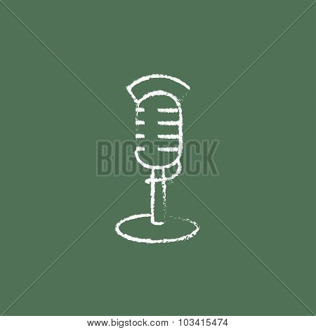 Microphone hand drawn in chalk on a blackboard vector white icon isolated on a green background.