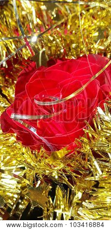 Christmas decoration natural red rose with gold tisel