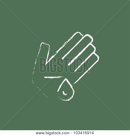 Wounded palm hand drawn in chalk on a blackboard vector white icon isolated on a green background.