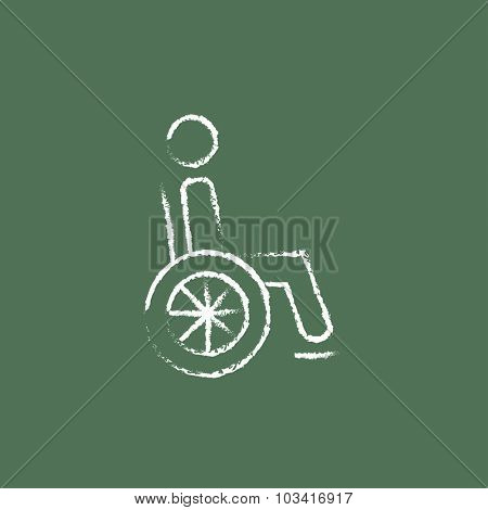 Disabled person hand drawn in chalk on a blackboard vector white icon isolated on a green background.