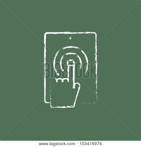 Touch screen lablet hand drawn in chalk on a blackboard vector white icon isolated on a green background.