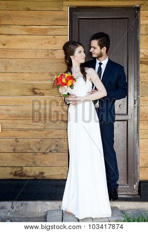 Young Just Married Couple In Front Of The Door