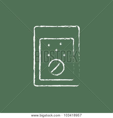 Tablet into a glass of water hand drawn in chalk on a blackboard vector white icon isolated on a green background.