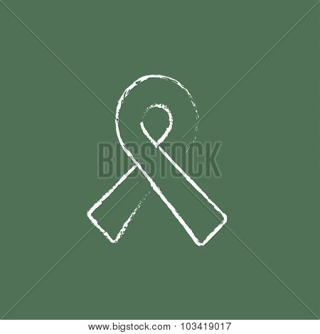 Ribbon hand drawn in chalk on a blackboard vector white icon isolated on a green background.