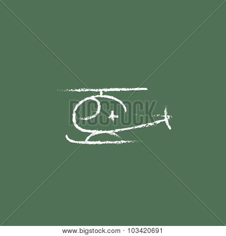 Air ambulance hand drawn in chalk on a blackboard vector white icon isolated on a green background.