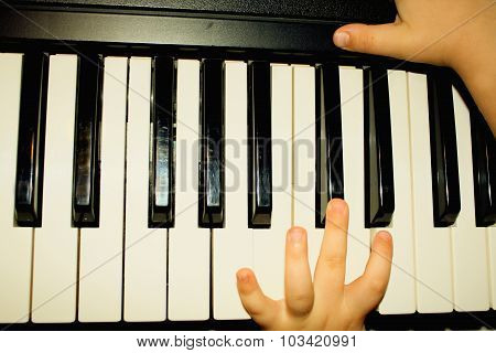 Hands Of Kid Who Playing Piano