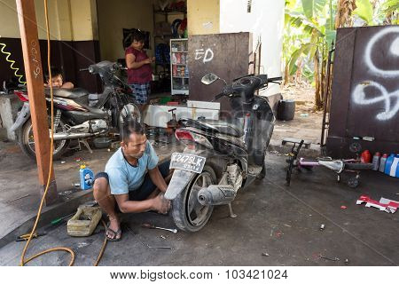 Service Man Repair Deflated Damaged Tyre