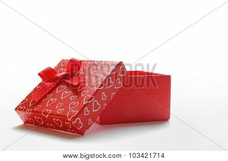 Open Red Gift With Bow And Painted Hearts Isolated Front