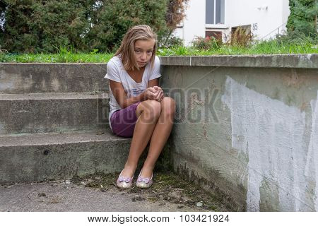 Sad Child Sits On Stairs Lonely