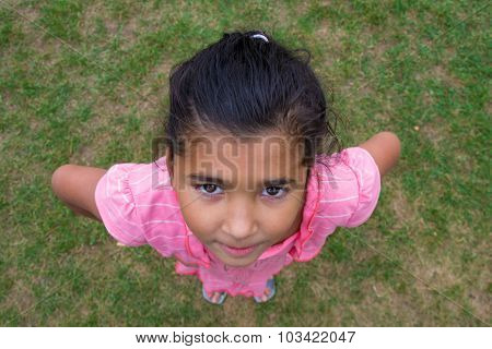 Happy Gypsy Child Girl Smiling, Shot From Above Perspective