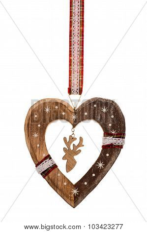Christmas decorative wooden heart isolated.