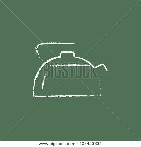 Kettle hand drawn in chalk on a blackboard vector white icon isolated on a green background.