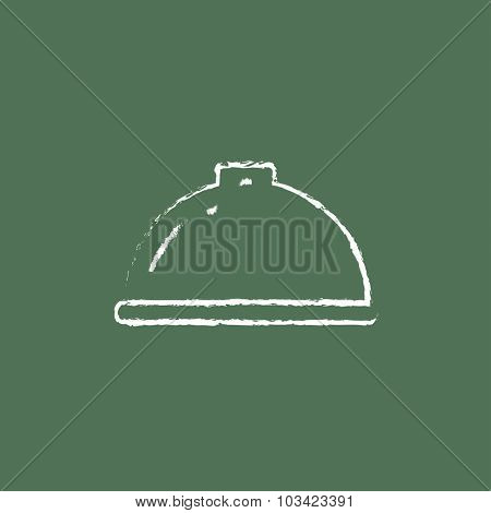 Restaurant cloche hand drawn in chalk on a blackboard vector white icon isolated on a green background.