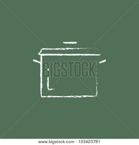Saucepan hand drawn in chalk on a blackboard vector white icon isolated on a green background.