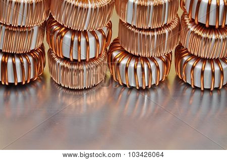 Electric copper coils on metal background