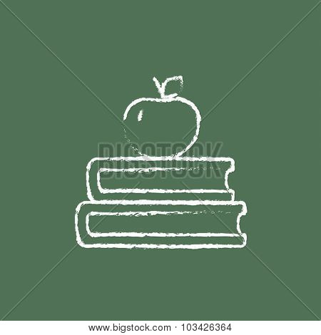 Books and apple on the top hand drawn in chalk on a blackboard vector white icon isolated on a green background.
