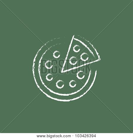 Whole pizza with a slice hand drawn in chalk on a blackboard vector white icon isolated on a green background.