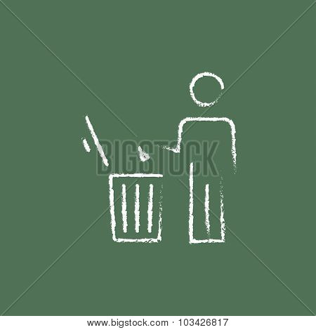 Man throwing garbage in a bin hand drawn in chalk on a blackboard vector white icon isolated on a green background.