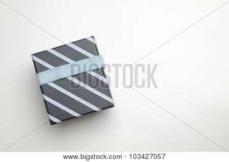 Black Gift Box With Ribbon And Blue Lines Top