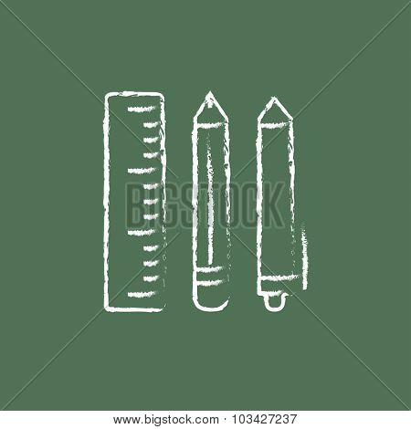 School supplies hand drawn in chalk on a blackboard vector white icon isolated on a green background.