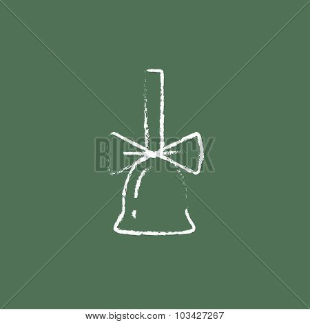 School bell with ribbon hand drawn in chalk on a blackboard vector white icon isolated on a green background.