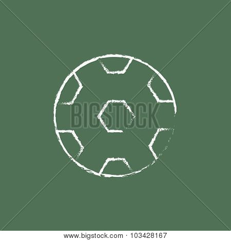 Soccer ball hand drawn in chalk on a blackboard vector white icon isolated on a green background.